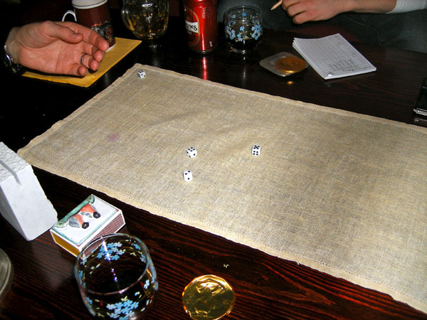 Dice game on coffee table
