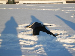 English Husband lying in snow