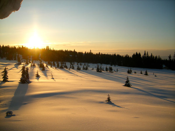 Sun rising over snow capped mountain plains