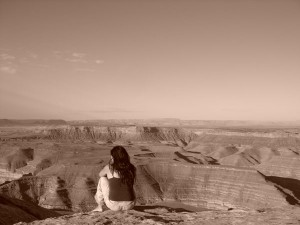 Me sitting on the edge of a cliff at Muley Point, Utah