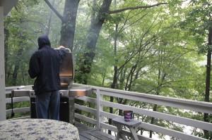 Man BBQing in the rain
