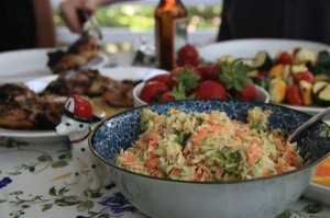 Homemade coleslaw on a table full of food