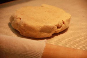 Pie crust dough on a pastry board