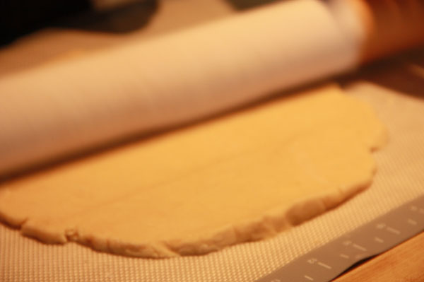 Rolling pin on pie crust dough
