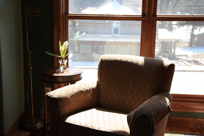 Big cozy arm chair in the sun