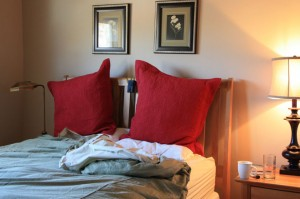 Bed with two big red pillows