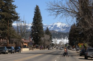 Main St Pagosa Springs with snow capped mountains in the background