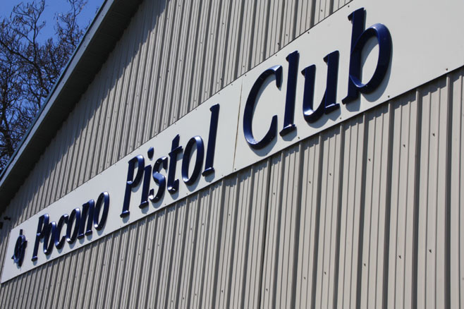Pocono Pistol Club sign on the side of a building