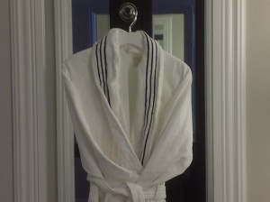 White bathrobe handing in front of a mirror
