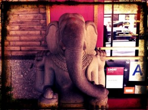 Elephant statue in front of doorway