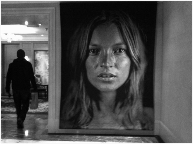Portrait of Kate Moss with man walking