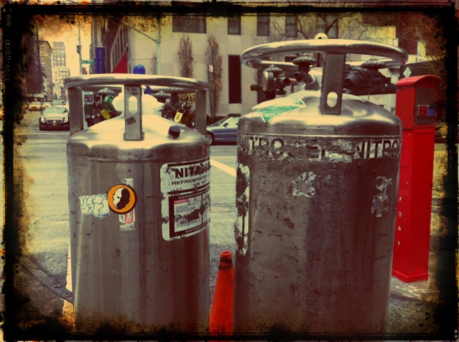 Two nitrogen tanks on the side of the street