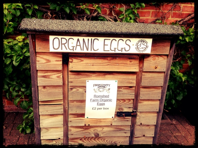 Small shed with organic egg sign