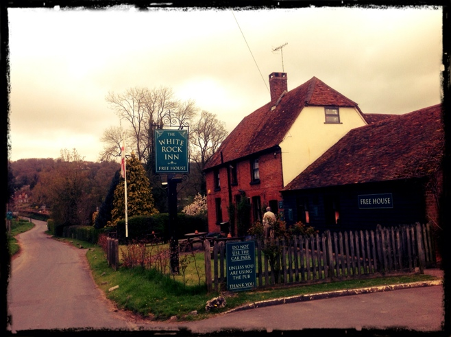 Old English pub with road running past