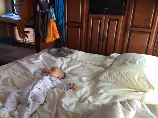 Baby spread out on a bed in the RV