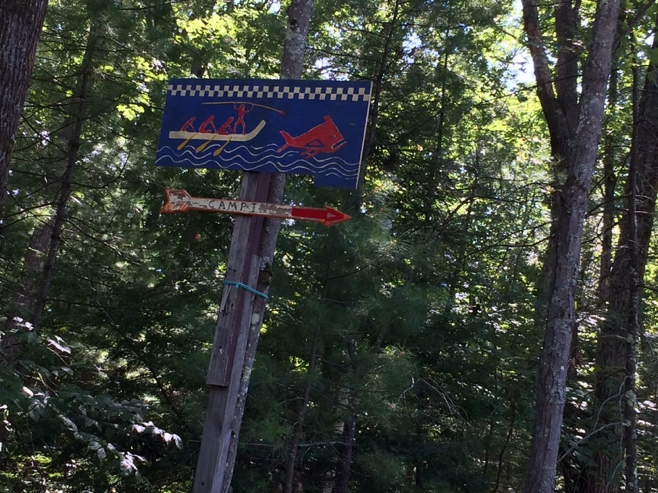 Camping sign in the woods