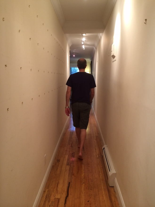 Man walking down hallway