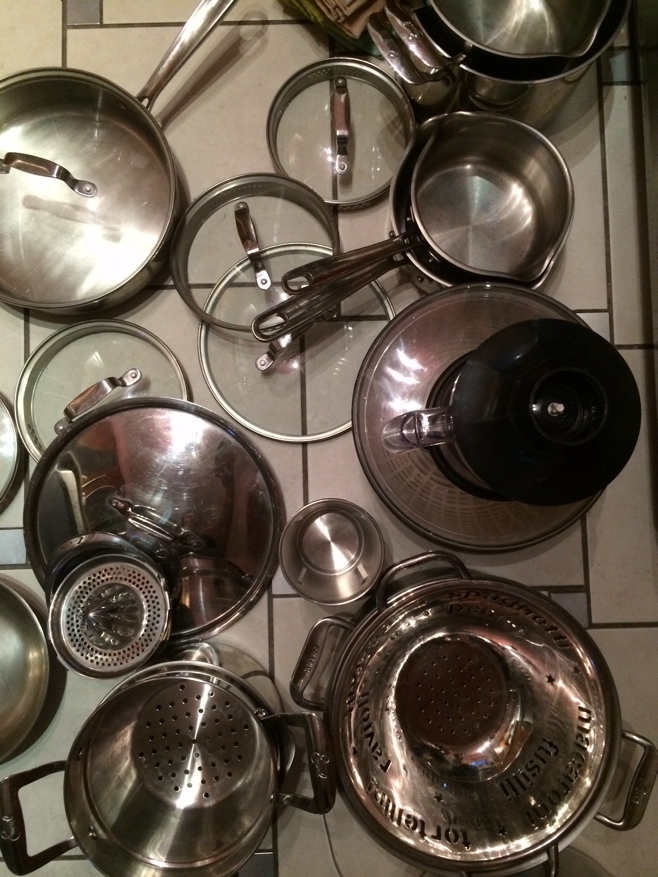 Kitchen pots and pans on a floor