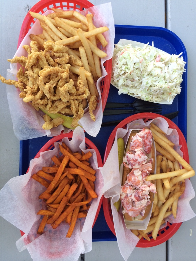 Lobster and clam rolls with fries and coleslaw