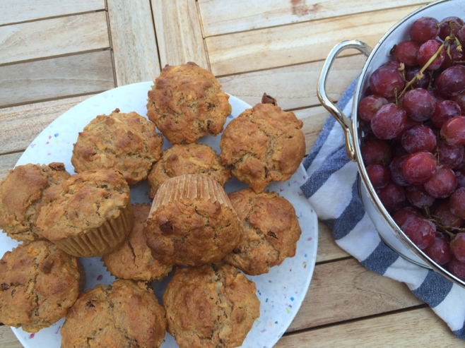 Muffins and grapes on a table