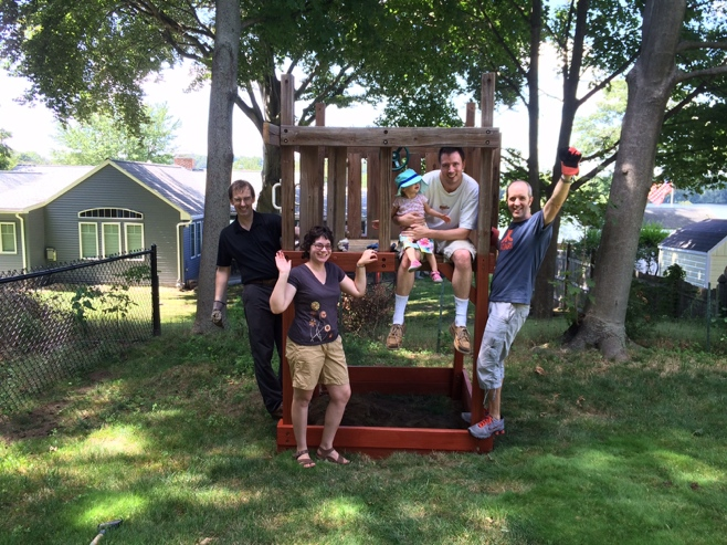 Four adults and one baby on a treehouse celebrating