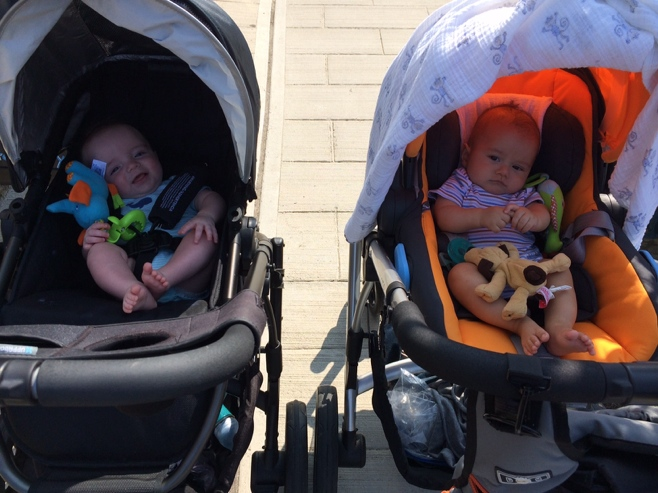 Two little babies in two strollers