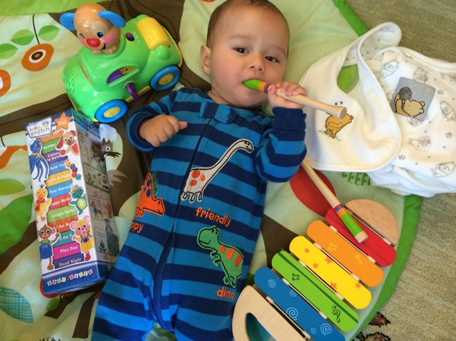 Baby surrounded by lots of toys