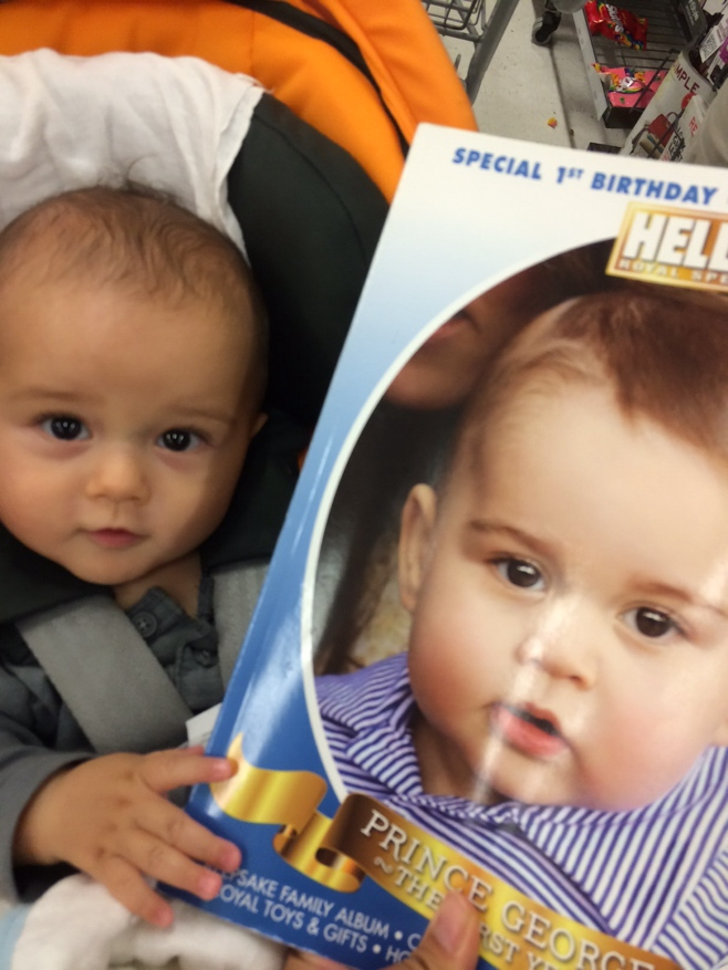 Baby with magazine of Prince George