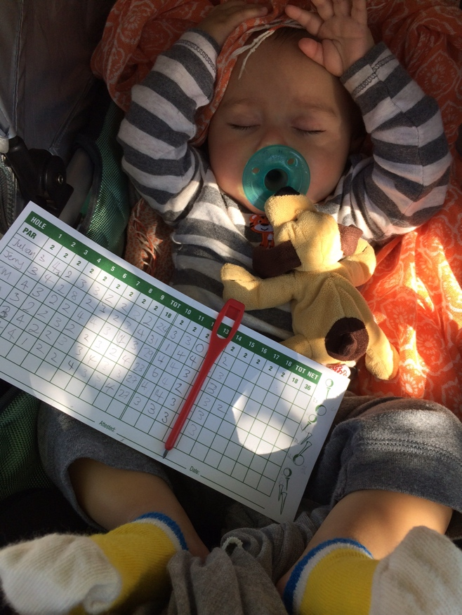 Baby sleeping with mini golf scorecard