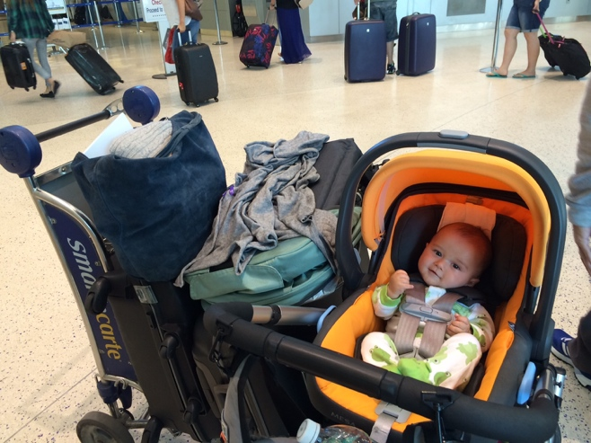 Baby with bags at the airport