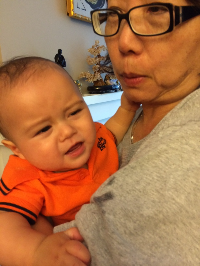 Baby in aunts arms getting grumpy