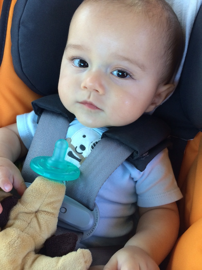 Baby in car seat with binky