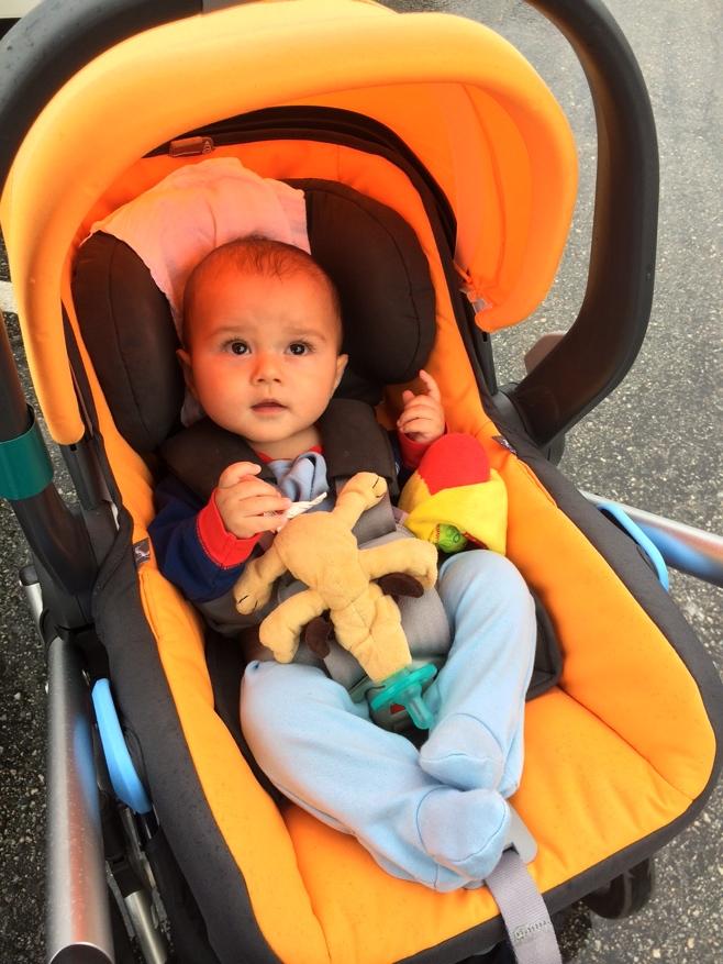 Baby in car seat in the rain