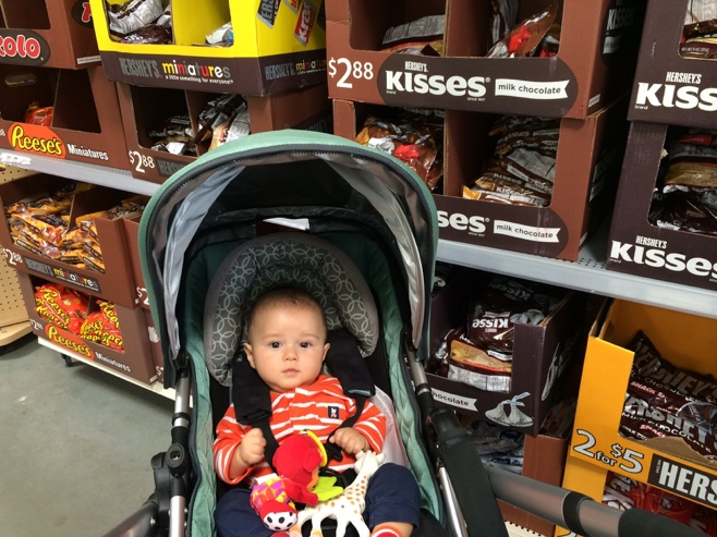 Baby in front of kisses stand