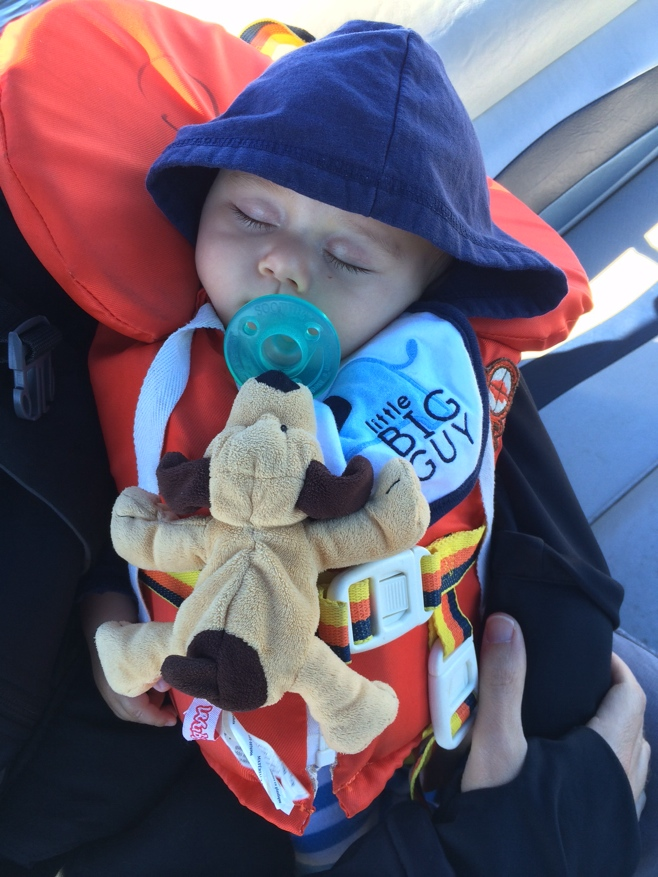 Baby in life jacket sleeping