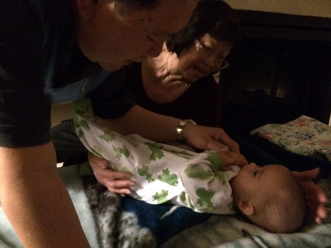 Baby meeting both grandparents