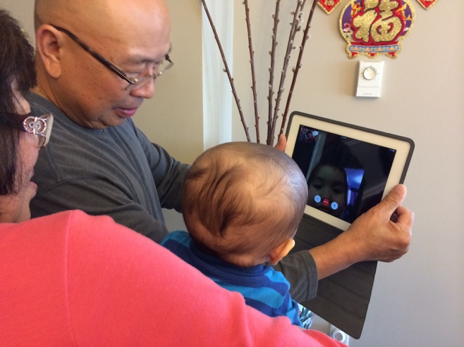 Baby with grandma looking at FaceTime