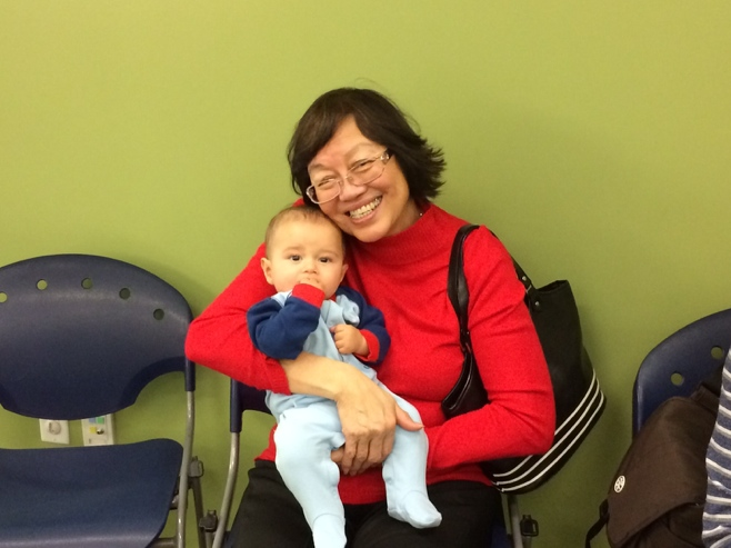Baby and grandma sitting in library