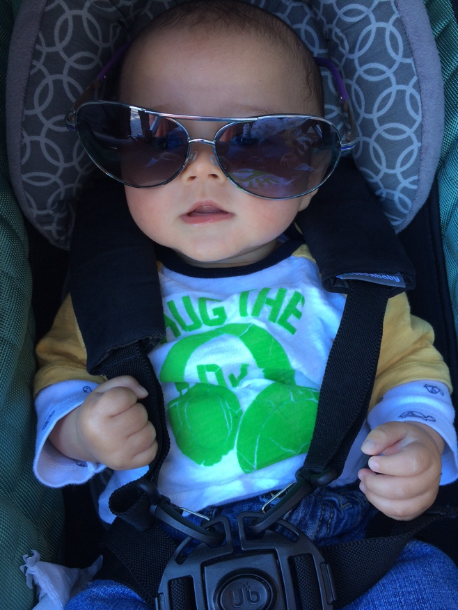 Baby with oversize sunglasses