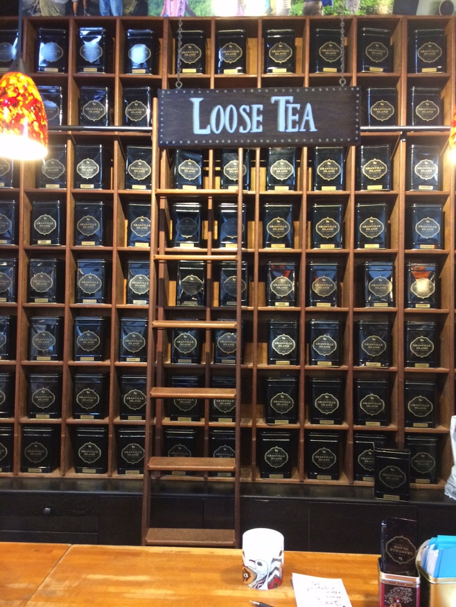 Boxes of loose tea along a wall