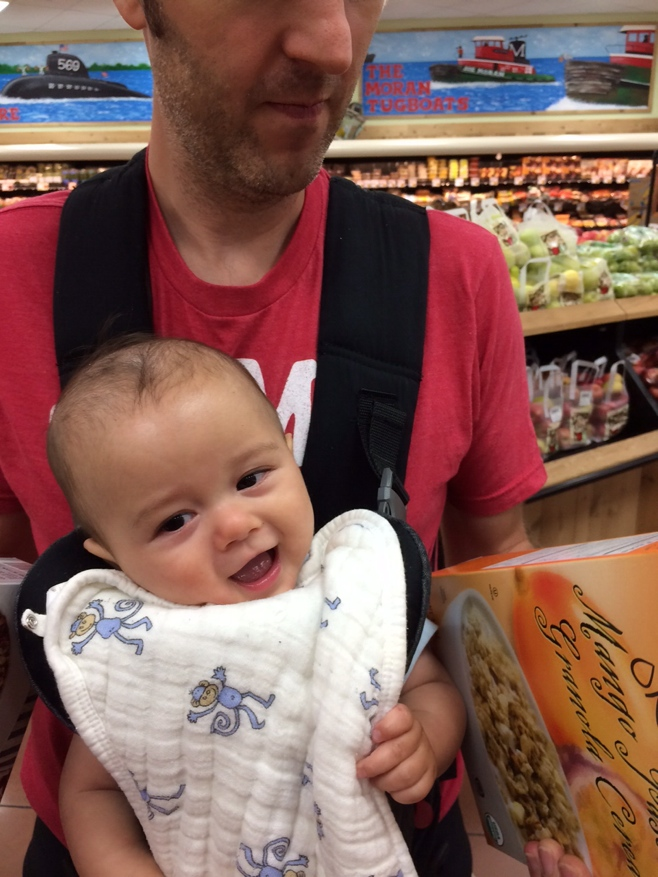 Dad and baby buying cereal in a supermarket