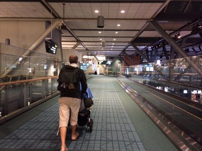 Dad pushing stroller in Vancouver airport