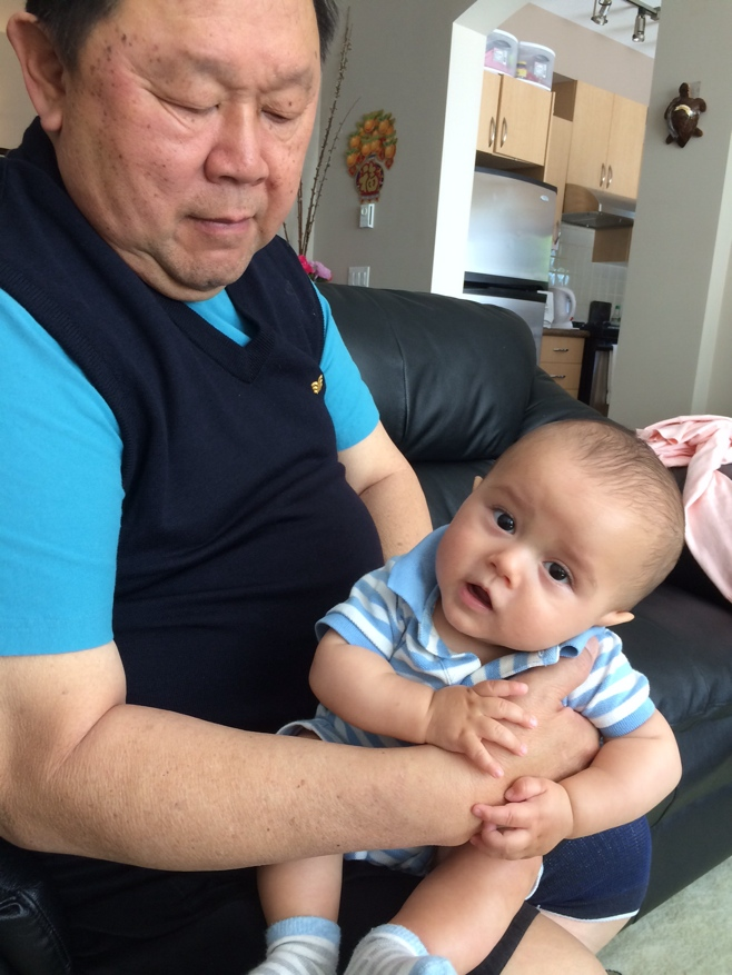 Grandpa with baby on lap