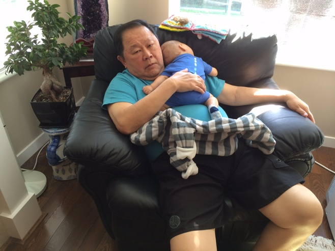 Baby sleeping on grandpa