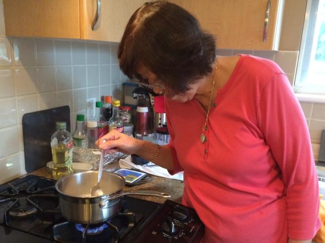 Grandma at stove cooking baby food