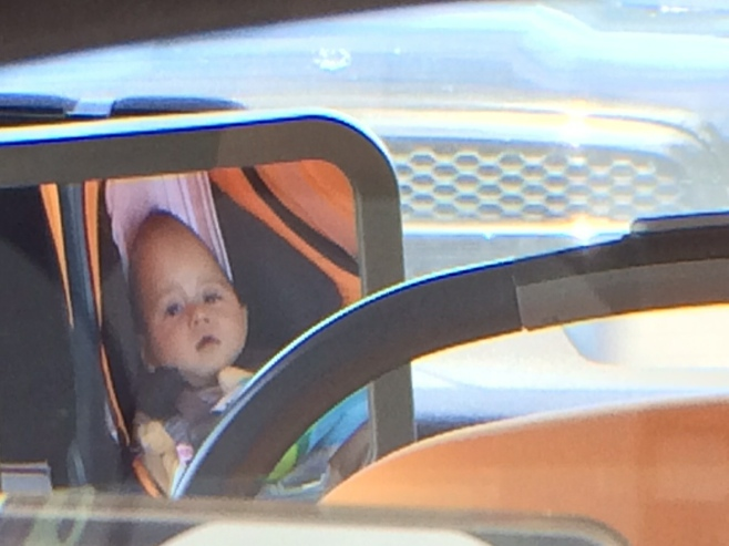 Baby in rear view mirror reflection
