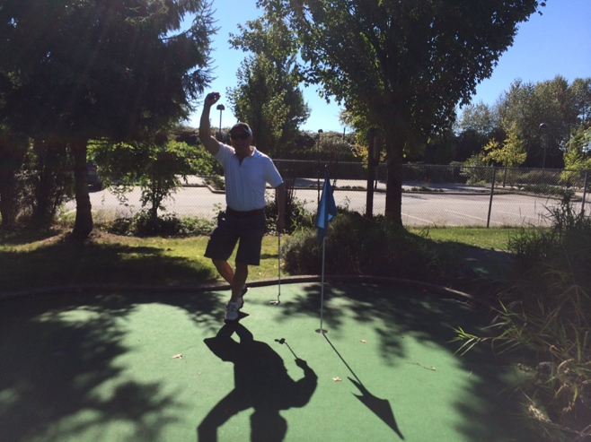Uncle celebrating hole in one