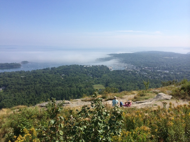 View from top of Camden hills with fog over harbor