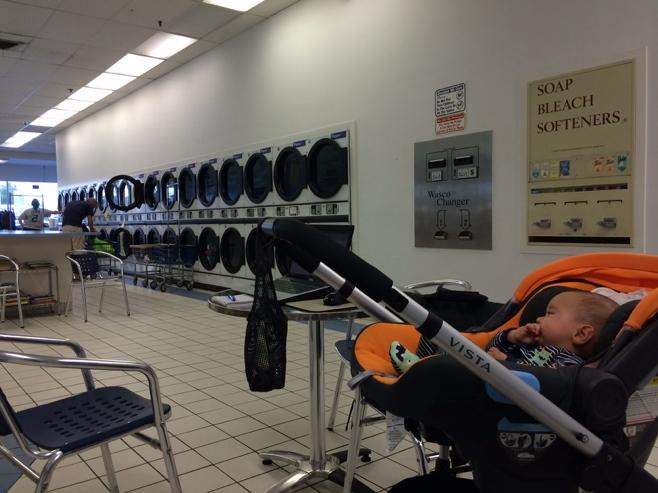 Baby in stroller in laundromat