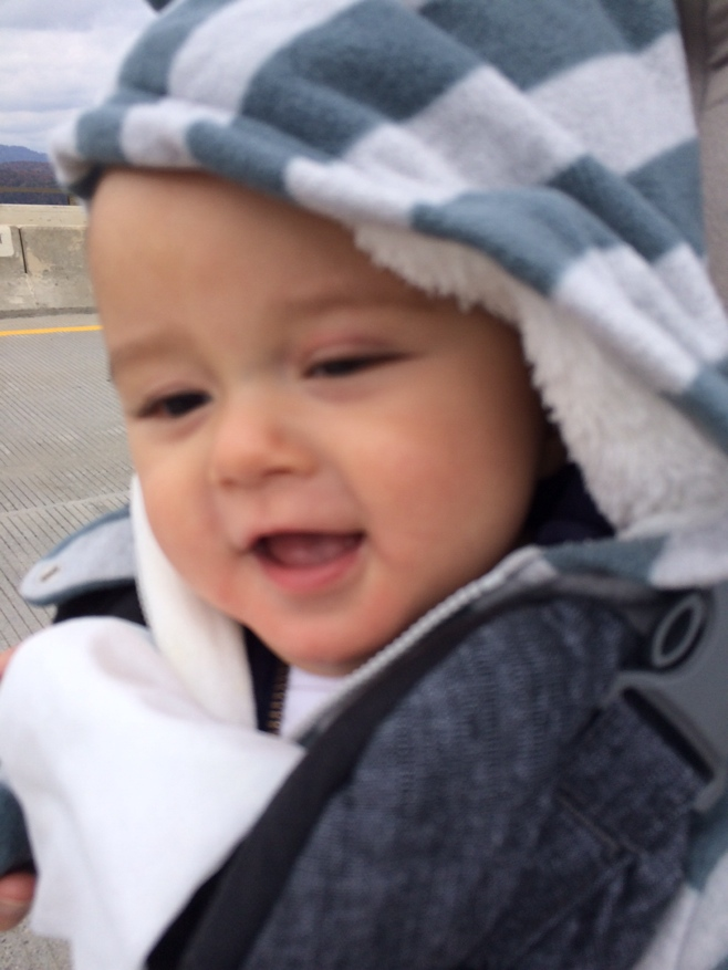 Baby with hoodie smiling